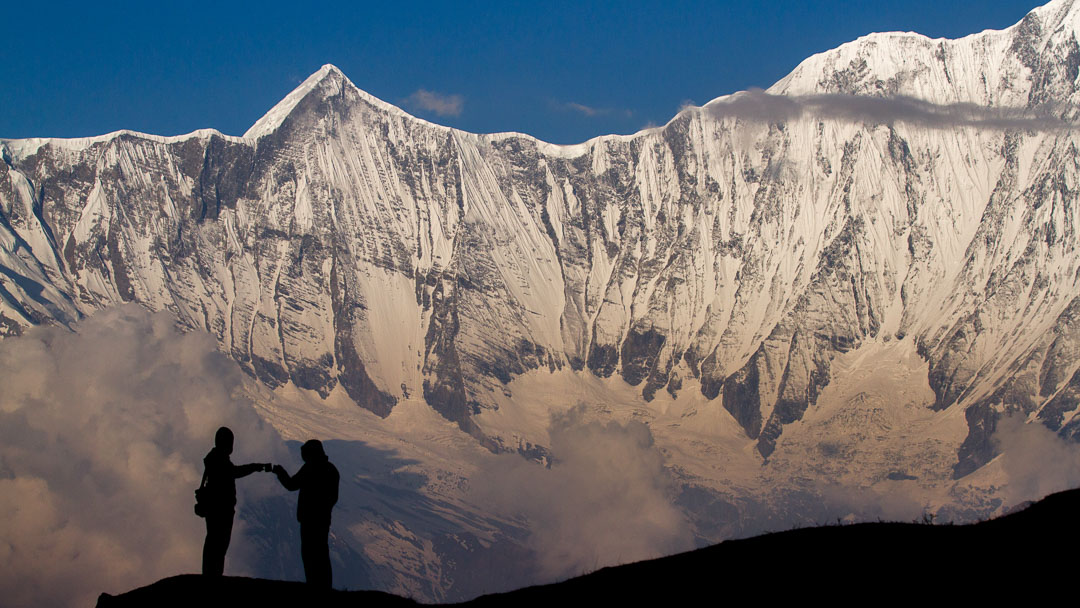 Two trekkers celebrate awesome views during the Annapurna Seven Passes Trek