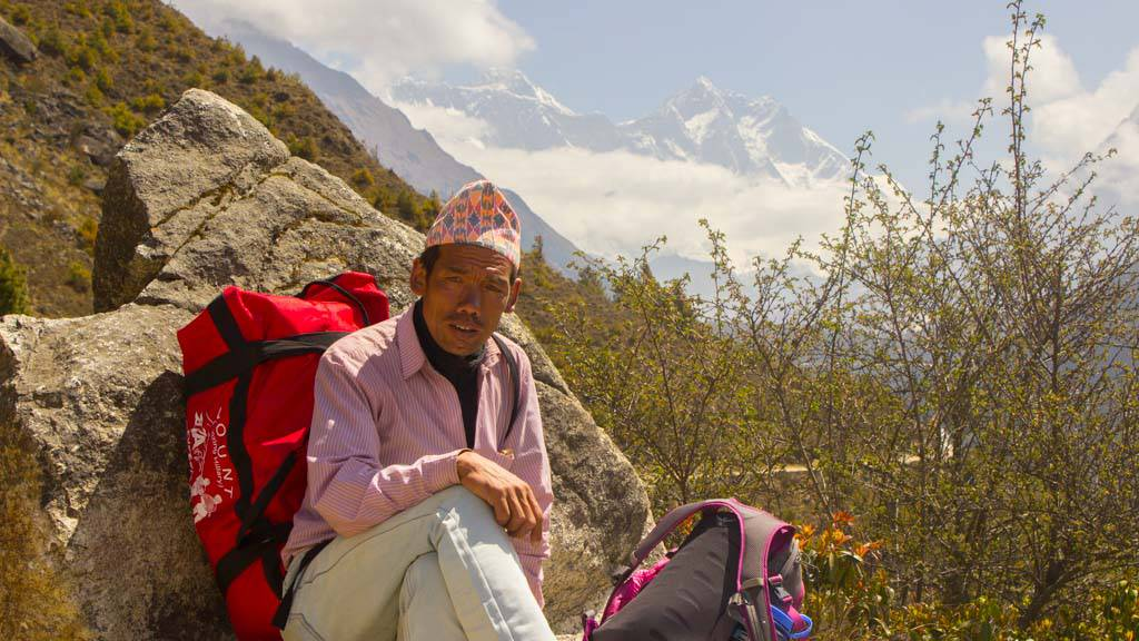 Indra Magar - A porter Guide from Lukla posing with Everest in the backdrop.