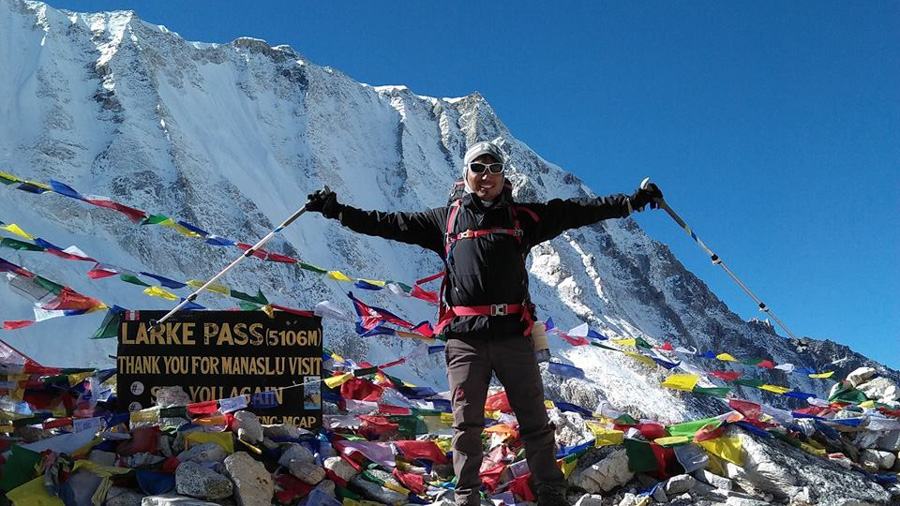 Bhim Tamang, an experienced trekking guide in Larke Pass after a successful ascent.
