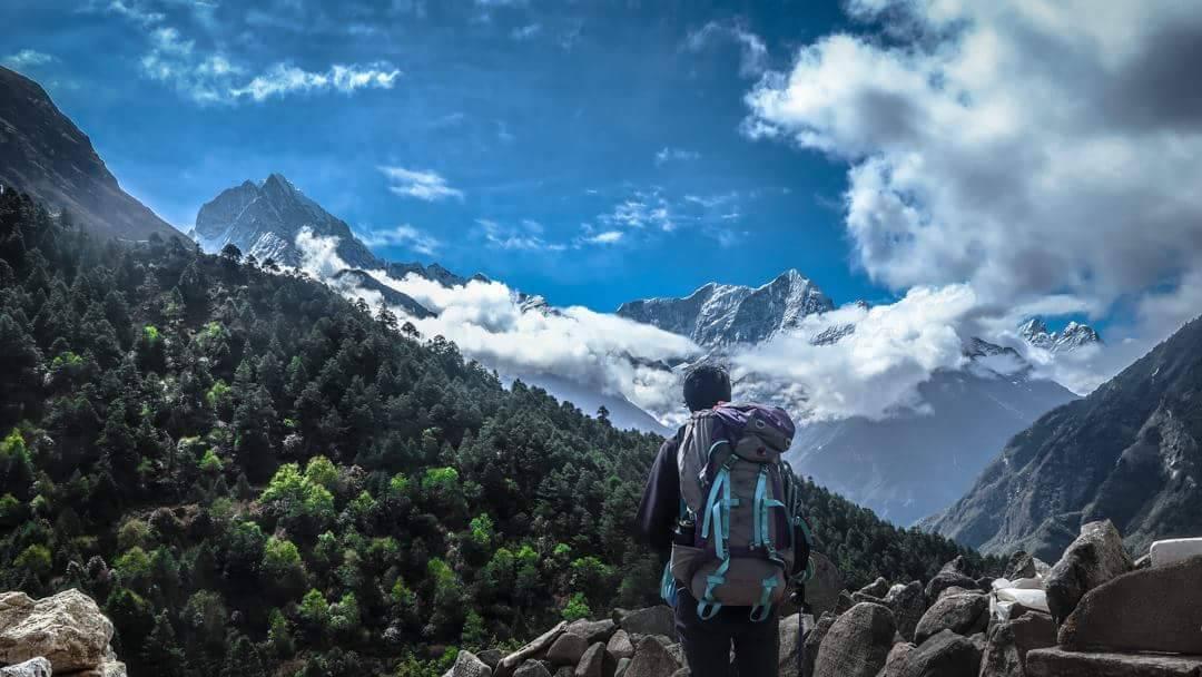 A solo trekker enjoying the mountains